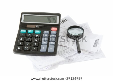 Planning  of family finances. Calculator, bills and magnifying glass isolated on a white background