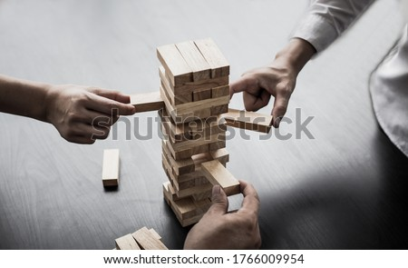Planning to reduce investment risks, plan and strategy in business, Establishing a business risk mitigation plan to create stability for the company, Business growth with wooden blocks concept.