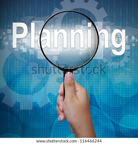 Planning, word in Magnifying glass; business background