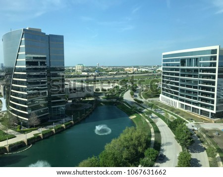 Plano, TX shot from office building with water tower and highway in the distance. Foto stock ©