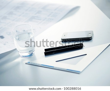 Plans and drawing instruments on the table