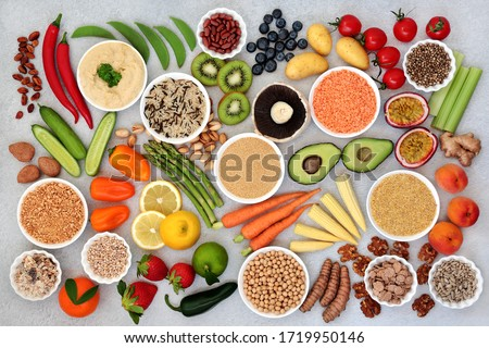 Plant based healthy diet vegan food with grains, nuts, seeds, fruit, vegetables, cereal, legumes & spice. High in antioxidants, anthocyanins, omega 3, vitamins, dietary fibre, smart carbs & protein.