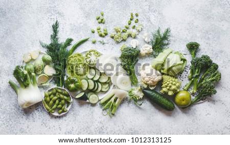 Plant based raw food seasonal vegetables background. Winter vegetarian, vegan food cooking ingredients. Flat-lay, top view #1012313125