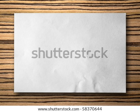 plant paper on zebrano Wood background