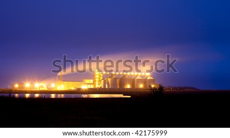 plant producing ethanol from corn - stock photo