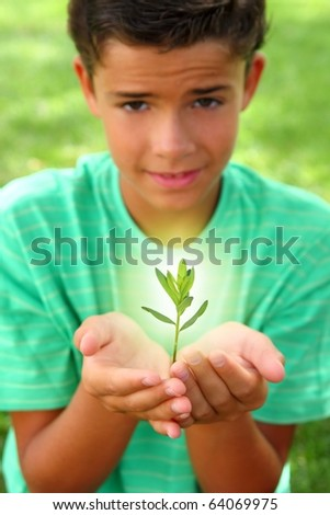 plant sprout growing glow light on teenager boy hands outdoors [Photo Illustration]