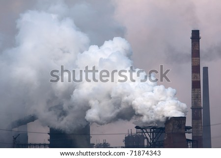Plant with smoke. Air pollution