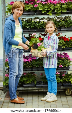 Planting, garden flowers - family shopping plants and flowers in garden center
