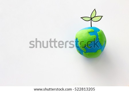 Stock Photo Planting tree in green globe , Environment conservation ,CSR Abbreviation or Corporate Social Responsibility