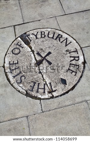 Plaque in London (located near Marble Arch) remembering the site of the Tyburn Tree.  This was the site of Tyburn gallows where prisoners were hung from the late 16th century. - stock photo