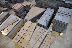 Plasma cutting at the factory. storage of finished parts with marking. Factory