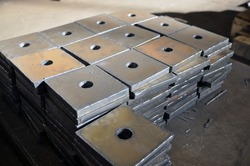 Plasma cutting of metal. Storing finished parts with a hole on a pallet.