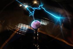 Plasma sphere static electricity line science. Hand touching plasma globe with plasma ray physics.