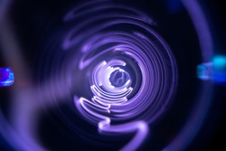 Plasma tunnel and violet electric flashes as abstract futuristic neon background