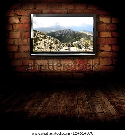 Plasma TV on the wall with possitive picture