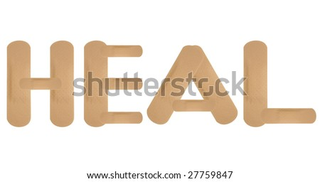 Plaster band aids spelling HEAL on white background