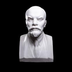 Plaster bust of Lenin on a black background