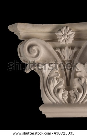 plaster graceful decorations on the columns on a black background #430925035