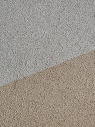 Plaster. Walls of plaster. Light dark background or backdrop in two colors. Light two-tone background. Monotonous color construction