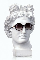 Plaster white bust Appolon head in sunglasses