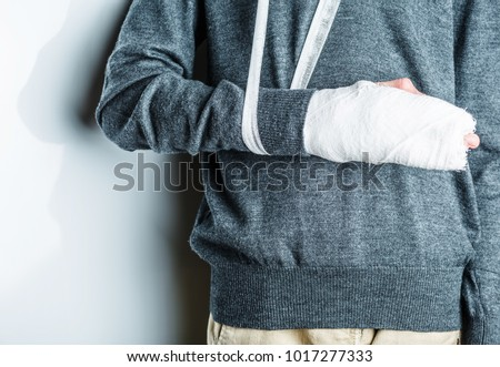 plastered arm, a broken arm at the teenager. on a white background