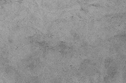 Plastered grey wall surface as a seamless background