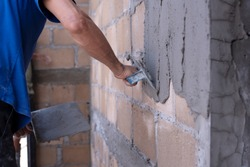 Plastering of plaster workers on the walls for building houses, repairing plaster, indoor walls and ceilings with floating and plastering