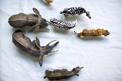 Plastic animal toys view from above on white back ground. elephants, zebras, cheetahs, rhinoceros and tigers.