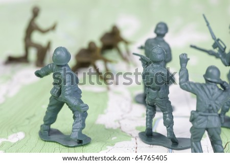 Plastic Army Men Fighting on Map. The map is by U.S. Geological Survey and in the public domain.