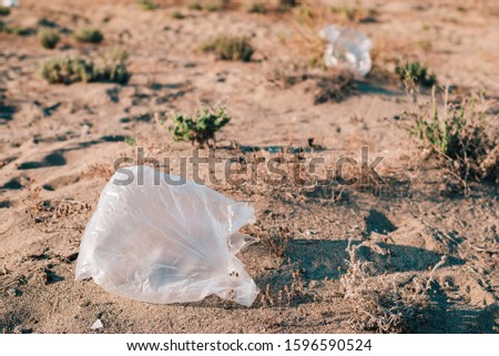 Plastic bags garbage on a beach. Earth pollution concept. Copy space. Copy space.