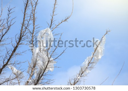 Plastic bags on the branches of trees,Nature ecology catastrophe #1303730578