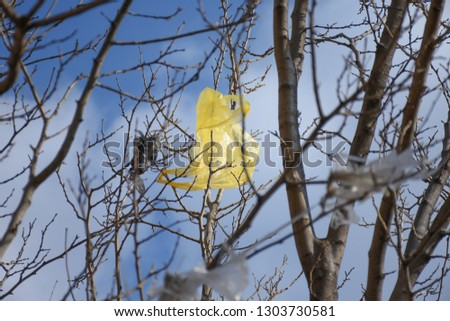 Plastic bags on the branches of trees,Nature ecology catastrophe #1303730581