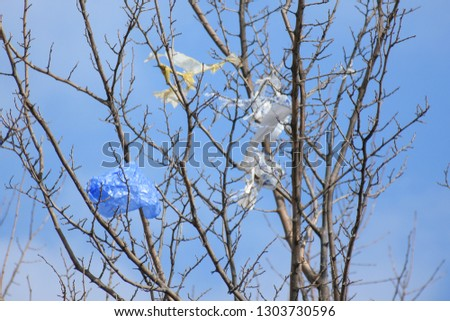Plastic bags on the branches of trees,Nature ecology catastrophe #1303730596