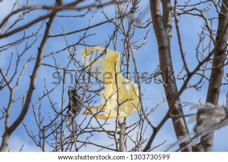 Plastic bags on the branches of trees,Nature ecology catastrophe #1303730599