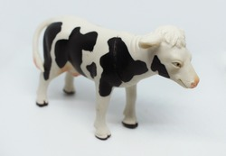 Plastic black and white Toy Cow