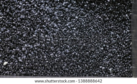 Plastic black gray granulated crumb. Manufacture of plastic water pipes of the factory. Process of making plastic tubes on the machine tool with the use of water and air pressure.