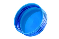 Plastic bottle caps isolated against a white background. of blue color