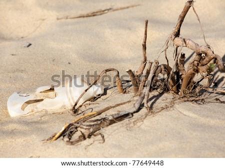 Plastic bottle left on a sandy beach