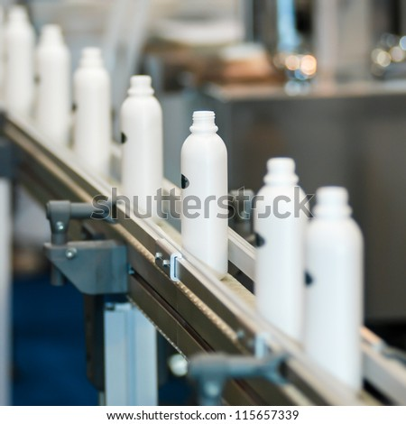 Plastic bottle on the conveyor
