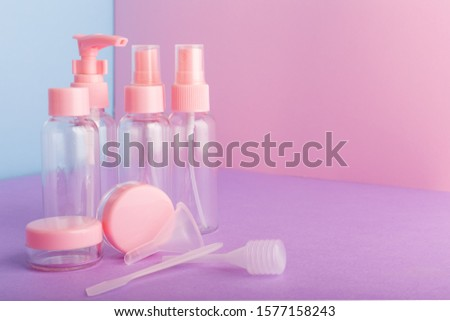 Plastic bottles for packaging hygiene products,homemade natural cosmetics,travel kit toiletries.Bottle, jar set on color pink background. Cosmetic package collection for cream, soaps, shampoo. Mock up
