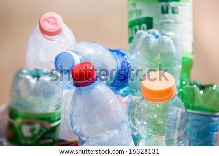Plastic bottles in a refuse bin.