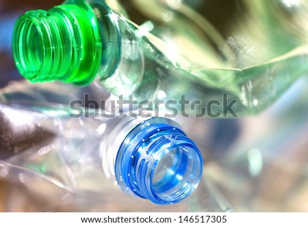 plastic bottles in the trash
