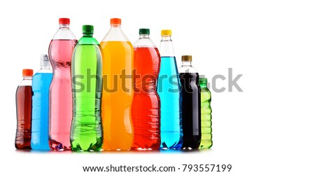 Plastic bottles of assorted carbonated soft drinks over white background #793557199