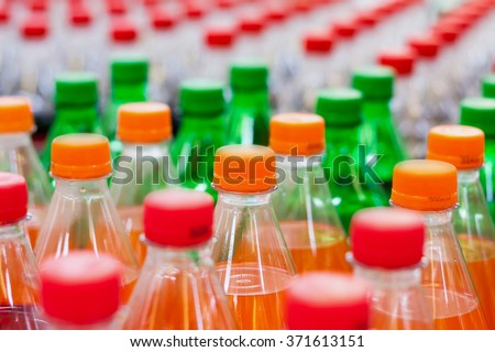 plastic bottles with soft drinks background