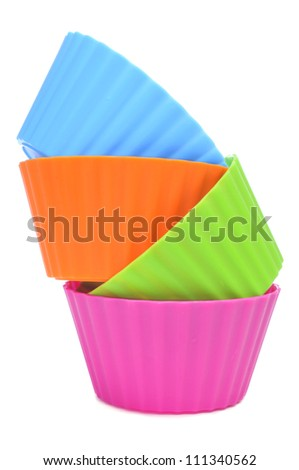 plastic bowls of different colors on a white background