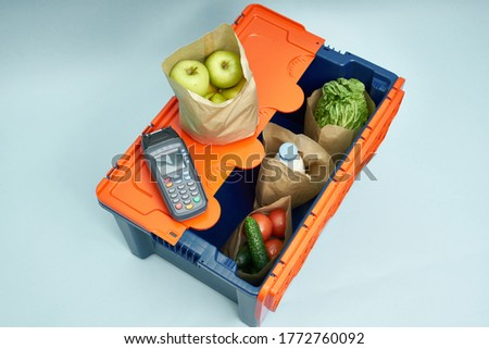 Plastic box with products. Food delivery in platinum boxes. Safe delivery. Storage of fragile goods.