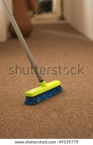 Plastic broom on carpet