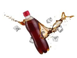 Plastic brown soda water bottle splash with ice cubes