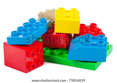 Plastic building blocks isolated over white background