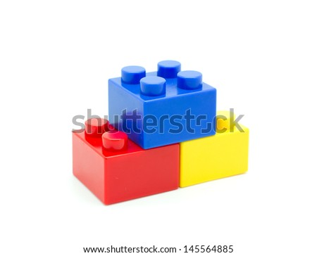 Plastic building blocks on white background